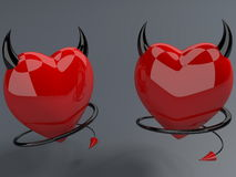 Devil red hearts with horns and tails Royalty Free Stock Image