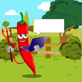 Devil red hot chili pepper holding laptop on a meadow Royalty Free Stock Photos