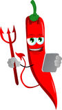 Devil red hot chili pepper using a tablet Royalty Free Stock Image