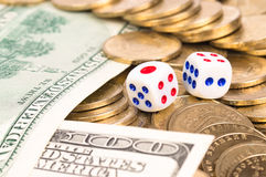 Devil's bones. Or dice, coins and dollars Stock Photography