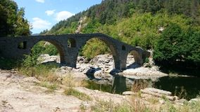 Devil`s Bridge. Is located near Ardino at the foot of the Arda River.According to some, one of the stones shows a footprint of the Devil`s footstep left after royalty free stock image