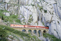 Devil's bridge (Teufelsbrücke). This railroad bridge is famously knows as Teufelsbrücke (devil's bridge) in Switzerland. The train passes the bridge just to Stock Photography