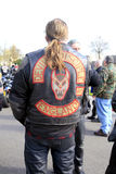 Devil's Disciple. A motorcyclist at an Hell's angel funeral with a Devil's Disciple jacket Royalty Free Stock Image