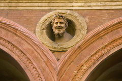 The devil's head on building in Bologna Royalty Free Stock Images