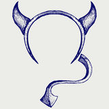 Devil's horns and tail Royalty Free Stock Photo