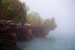 Fog Over Devils Island Sea Caves stock photos