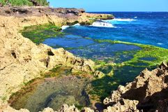 Beside devil& x27;s tear. Amazing rock formation beside the more popular rock formation devil& x27;s tear in Nusa lembongan bali Indonesia. Still ponds beside royalty free stock images