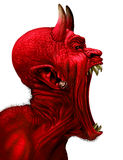 Devil Scream. Character as a red demon or monster screaming with fangs and teeth with in an open mouth as a side view horror face isolated on a white background Stock Photo