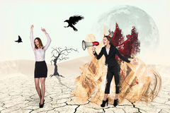 Devil screaming to loudspeaker on businesswoman Stock Photography