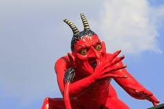 Devil sculpture Stock Images