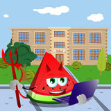 Devil slice of watermelon holding laptop in front of a school Royalty Free Stock Photo