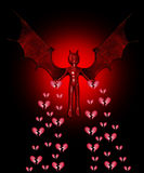 Devil Spreading The Heartbreak. The devil spreading sadness and broken hearts everywhere Royalty Free Stock Photo