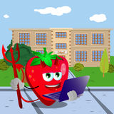 Devil strawberry holding laptop in front of a school Royalty Free Stock Image