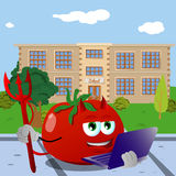 Devil tomato holding laptop in front of a school Royalty Free Stock Photography