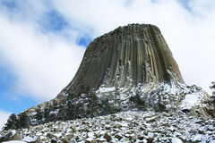 Devil Tower cover with snow. Devil Tower national monument covered with snow wrapping with blue sky royalty free stock photos