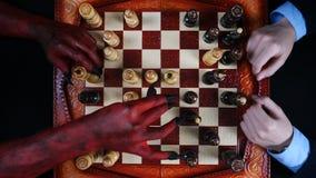 Devil wins by checkmate businessman. Devil wins a businessman in chess. 4K