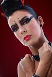 Devil woman with clenched fists Royalty Free Stock Images