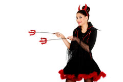 Devil woman pointing aside with trident. Royalty Free Stock Photos