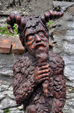 Devil. Wooden statue of the devil stock photo