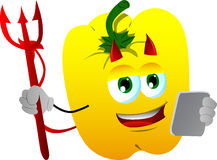 Devil yellow bell pepper using a tablet Stock Photos