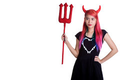Devil young girl holding trident Stock Photography