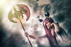 Devil young woman with spear pitchfork, hell demon in cloudy sky Royalty Free Stock Images