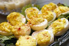 Deviled Eggs. Sitting on a bed of lettuce in a crystal serving dish Royalty Free Stock Images
