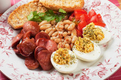 Deviled eggs with beans and sausage Royalty Free Stock Images