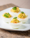 Deviled eggs garnished with parsley and paprika Stock Photography