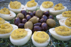 Deviled Eggs and Olives before dinner Stock Images