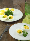 Deviled eggs with parsley Stock Photos