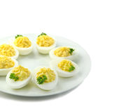 Deviled eggs with parsley in a plate Stock Photography