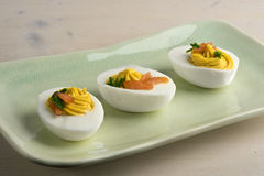 Deviled eggs with smoked salmon and chives Stock Images