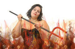 Devilish. Beautiful large young woman with devil's fork isolated in white Stock Photo