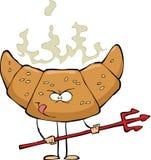 Devilish croissant Royalty Free Stock Image