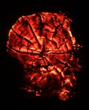 Devilish Embers. This is an image of a burning mesquite trunk.  The spider-web pattern formed by the age rings and cracks in the stump were fascinating, but Stock Photos