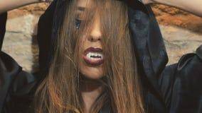 Devilish female vampire scaring on the camera. In full HD stock video