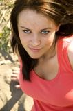 Devilish girl. Woman in pink tank top with a devilish look royalty free stock photos