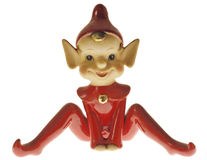 Devilish Pixie Elf. Antique (circa 1950's) porcelain pixie, uplit to accent its impish attitude stock photography