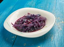 Devilish red cabbage. Mouthwatering winter warmer of red cabbage stewed with apples and spices Stock Images