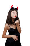 Devilish woman with horns Stock Image