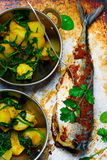 Devilled mackerel with potatoes and spinach..style vintage stock photography