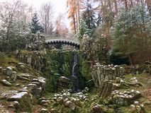 Devils Bridge at Bergpark Wilhelmshöhe. Kassel, Germany. UNESCO World-Heritage listed park in the centre of Germany. Take on an early winter day, with snow on Stock Photos