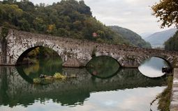 Devils Bridge Italy Ponte della Madalene. The oldest humpback bridge in Italy the Ponte di Diavolo, or Devils bridge spans a peaceful spot over the Serricho Royalty Free Stock Photos