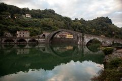 Devils Bridge Italy. The oldest humpback bridge in Italy the Ponte di Diavolo, or Devil's bridge spans a peaceful spot over the Serricho river. Built around 1080 Stock Images