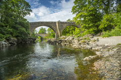 Devils Bridge near Kirkby Lonsdale, Cumbria. The Devils Bridge over the River Lune, at Kirkby Lonsdale, Cumbria, England, with the new road Stanley bridge in the Stock Photos