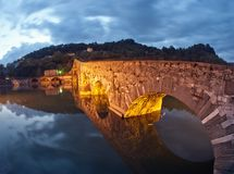 Devils Bridge at Night in Lucca, Italy stock photo