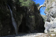 The Devils Bridge and waterfall in Gole del Raganello. National Park Pollino Stock Photography