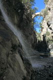 The Devils Bridge and waterfall in Gole del Raganello. National Park Pollino Royalty Free Stock Photography