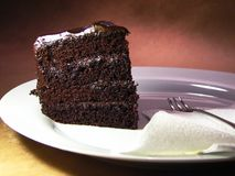 Devils chocolate cake. Slice of layered chocolate cake stock image